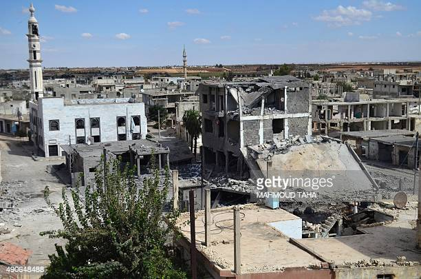 A picture taken on September 30 2015 shows a general view of deserted streets and damaged buildings in the central Syrian town of Talbisseh in the...