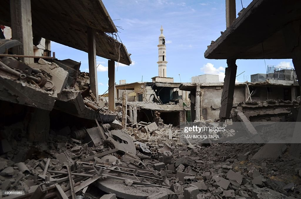 A picture taken on September 30 2015 shows damaged buildings and a minaret in the central Syrian town of Talbisseh in the Homs province Russian...