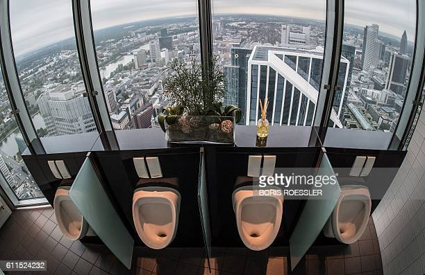 Picture taken on September 30 2016 shows the men's toilets in the 49th floor of the Commerzbank headquarters from where toilet goers can enjoy a...