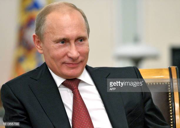 A picture taken on September 5 shows Russia's President Vladimir Putin smiling during a meeting in his NovoOgaryovo residence outside Moscow Putin...