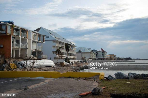 A picture taken on September 7 2017 shows damaged houses on the shore line of Marigot on the French Carribean island of SaintMartin after the passage...