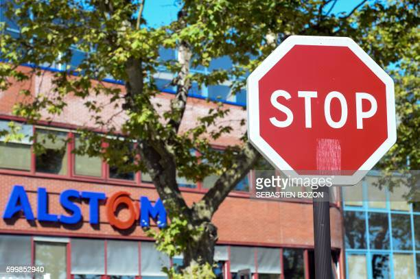 A picture taken on September 7 shows the logo of the French power and transport engineering company Alstom in Belfort behind a stop road sign French...