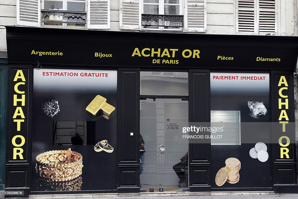 A picture taken on September 8 2011 in Paris shows the window of a shop that buys sales and estimates gold and jewllery AFP PHOTO FRANCOIS GUILLOT