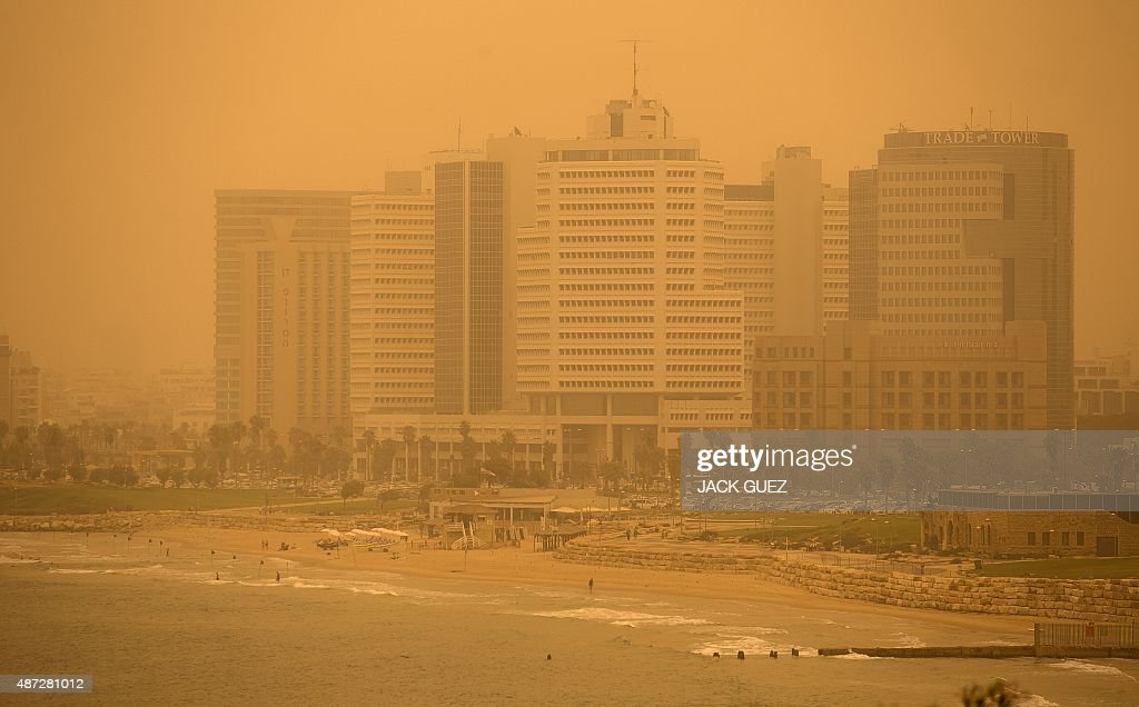 A picture taken on September 8 2015 shows a general view of a beach in the Israeli coastal city of Tel Aviv during a sandstorm A dense sandstorm...