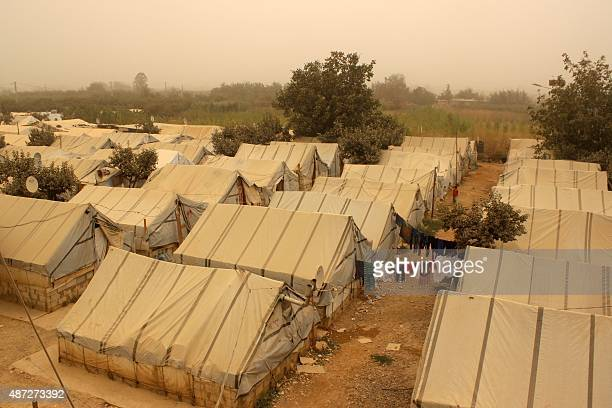 A picture taken on September 8 2015 shows tents during a sandstorm at a refugee camp near the Bekaa Valley village of Taalabaya Two people have died...