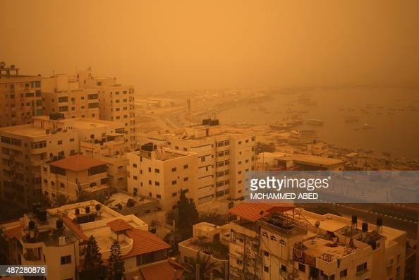A picture taken on September 8 shows Gaza City's seafront shrouded in a thick cloud of dust as a sandstorm engulfs parts of the Middle East AFP PHOTO...
