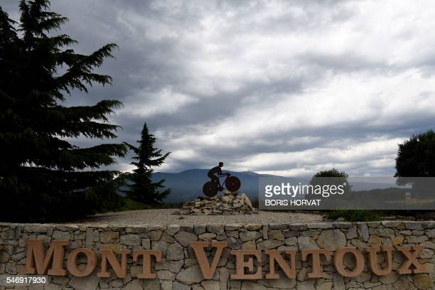 A picture taken on the Mont Ventoux on July 12 2016 two days before the passage of the Tour de France shows a sculpture of a cyclist / AFP / BORIS...
