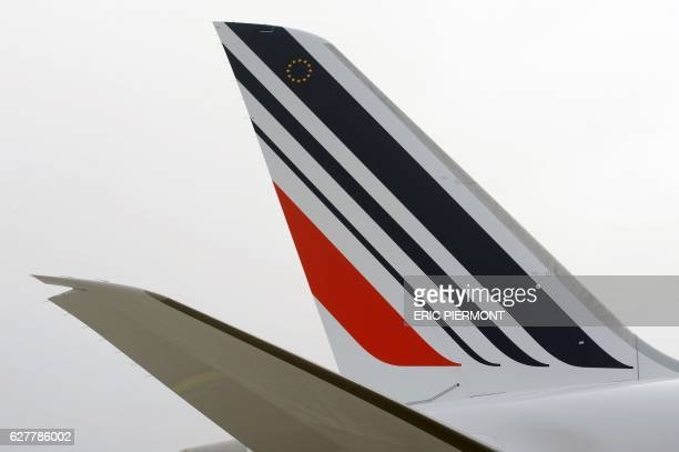 A picture taken on the tarmac at Roissy Paris Charles de Gaulle airport on December 2 2016 shows a view of the tail of an Air France plane / AFP /...