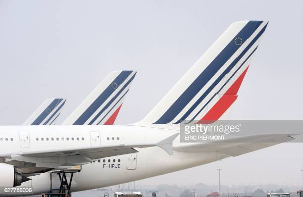 A picture taken on the tarmac at Roissy Paris Charles de Gaulle airport on December 2 2016 shows tails of Air France planes / AFP / ERIC PIERMONT