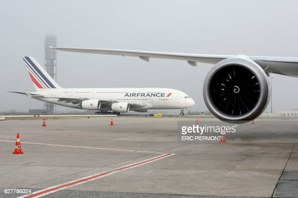 A picture taken on the tarmac at Roissy Paris Charles de Gaulle airport on December 2 2016 shows an Air France Airbus A 380 moving / AFP / ERIC...
