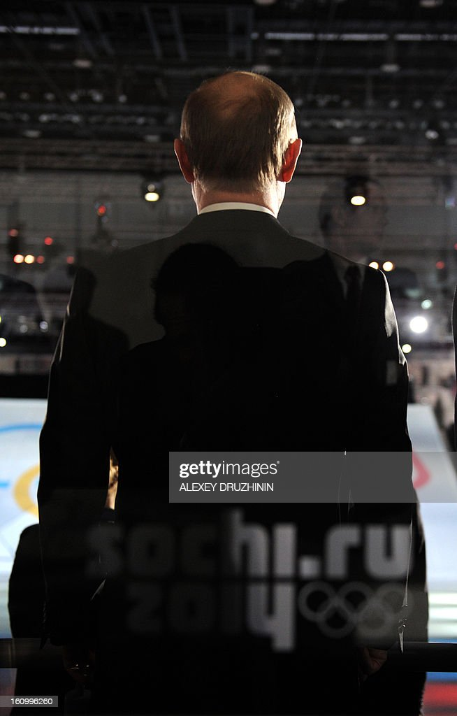 A picture taken through a glass on February 7, 2013, shows Russia's President Vladimir Putin taking part in a ceremony celebrating the one year countdown to the Sochi 2014 Winter Olympics opening at the Bolshoi Ice Dome rink in the Black Sea city of Sochi. Putin vowed yesterday Russia would justify expectations when it hosts the Winter Olympic Games in Sochi in one year, after ruthlessly firing an official blamed for delays in building infrastructure.