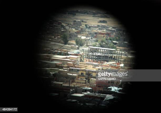 A picture taken through a machine gun sight on August 17 2015 shows buildings that were damaged during fighting between Iraqi Kurdish Peshmerga...