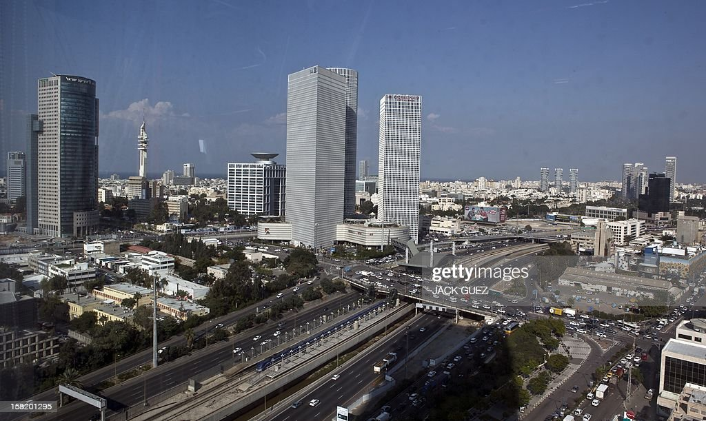 A picture taken through a window, shows a general view of the skyline of the Israeli Mediterranean coastal city of Tel Aviv, as seen from one of its high-rise buildings on December 10, 2012. Tel Aviv, founded in 1909 under the British Mandate in Palestine, has been dubbed as the 'White City' due to the extensive building activities based on the urban plan of Sir Patrick Geddes that reflected modern organic planning principles.