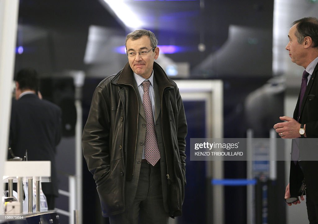 A picture taken through a window shows French bailiff Denis Calippe (L) leaving the French opposition UMP right-wing party, on November 26, 2012 in Paris after a working session of the UMP's appeal elections control board which confirmed the decision of the UMP's elections control committee (COCOE) declaring the victory of Jean-Francois Cope as new president of UMP, on November 19, 2012. This appeal followed the failure of the mediation by party heavyweight Juppe, a former premier and foreign minister, with the right-winger, who was declared the winner of November 22 knife-edge vote to pick a party leader, Jean-Francois Cope, and his centrist rival Francois Fillon.