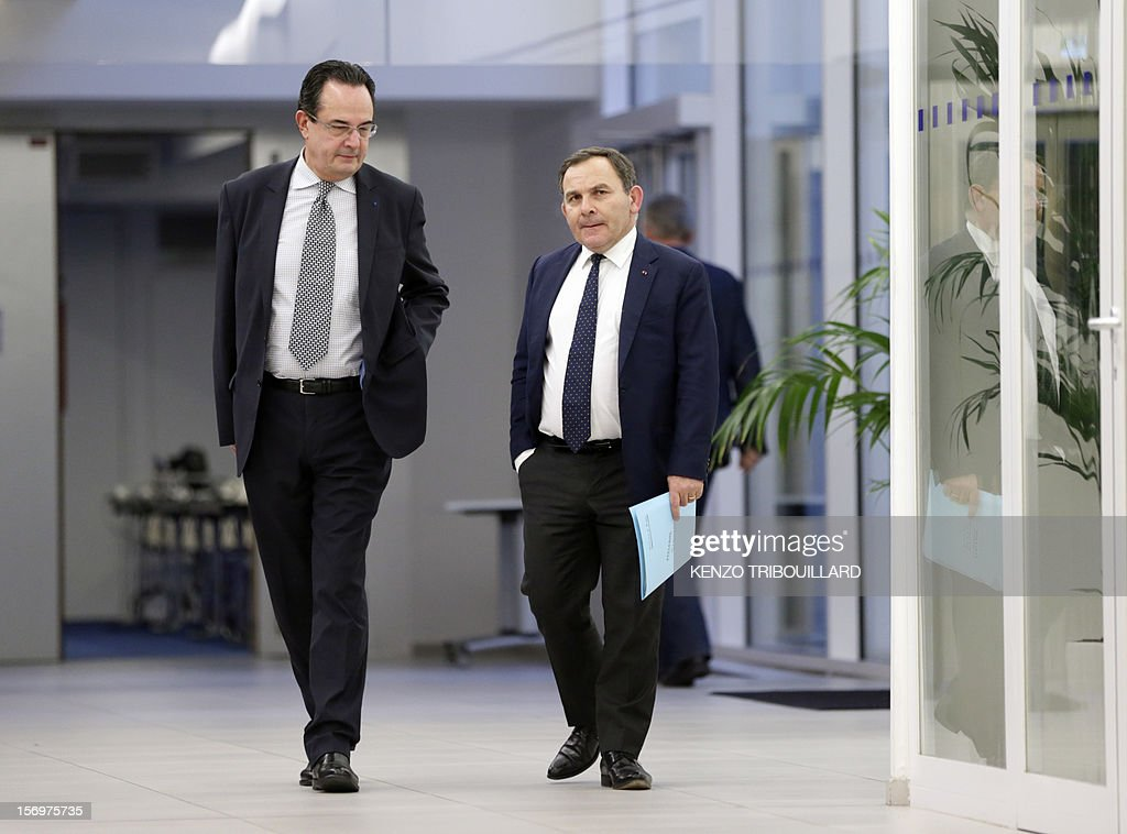 A picture taken through a window shows French lawyer Francis Szpiner (R), supporter of Jean-Francois Cope, the new president of French opposition UMP right-wing party, leaving, on November 26, 2012 in Paris after a working session of the UMP's appeal elections control board which confirmed the decision of the UMP's elections control committee (COCOE) declaring the victory of Cope, on November 19, 2012. This appeal followed the failure of the mediation by party heavyweight Alain Juppe, a former premier and foreign minister, with the right-winger, who was declared the winner of November 22 knife-edge vote to pick a party leader, Jean-Francois Cope, and his centrist rival Francois Fillon.