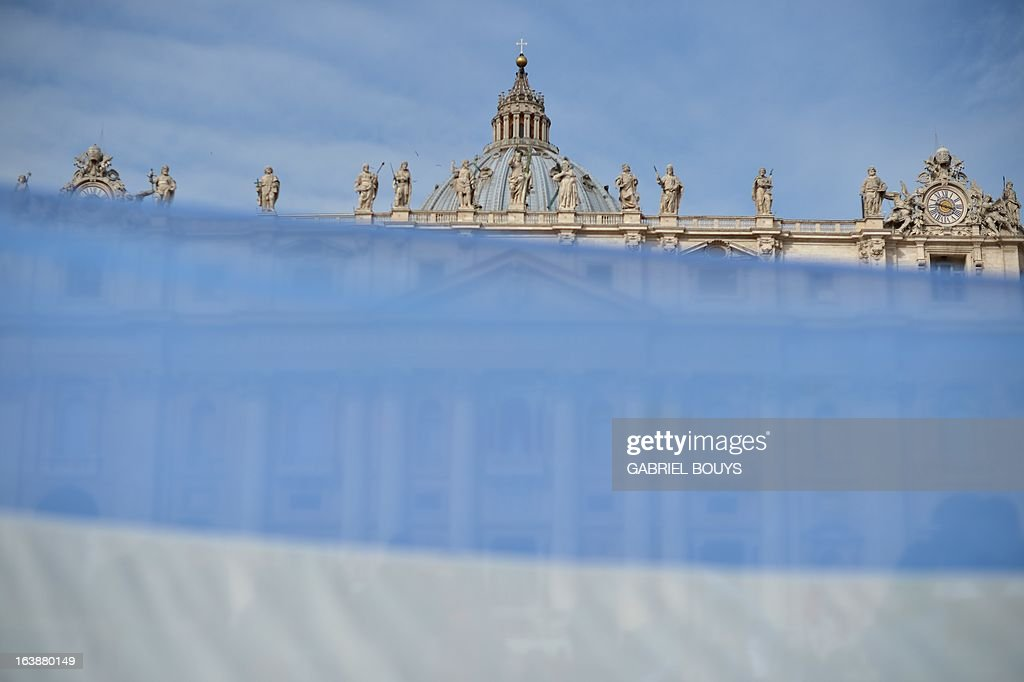 A picture taken through an Argentinian flag shows St Peter's basilica before pope's first Angelus prayer at St Peter's square on March 17, 2013 at the Vatican. Pope Francis begins his papacy in earnest today ahead of his formal inauguration mass, with a weekly prayer address used by previous pontiffs to comment on international affairs. The pope's first Angelus prayer, delivered from a window high above St Peter's Square, is a chance for the first Latin American pontiff to begin to sketch out a more global vision for the role of the Roman Catholic Church.