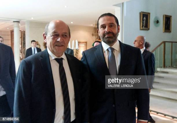 A picture taken with a cellphone on November 16 shows French Foreign Minister JeanYves Le Drian posing for a photo with Lebanese Prime Minister Saad...