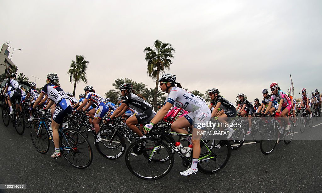A picture taken with a fish-eye lens shows cyclists competing in the first stage of the Tour of Qatar women's cycling race in the capital Doha, on January 29, 2013. The route of the first stage covers 97 kilometres from the Qatar Islamic Art Museum to the southern city of Mesaieed. AFP PHOTO / AL-WATAN DOHA / KARIM JAAFAR == QATAR OUT ==