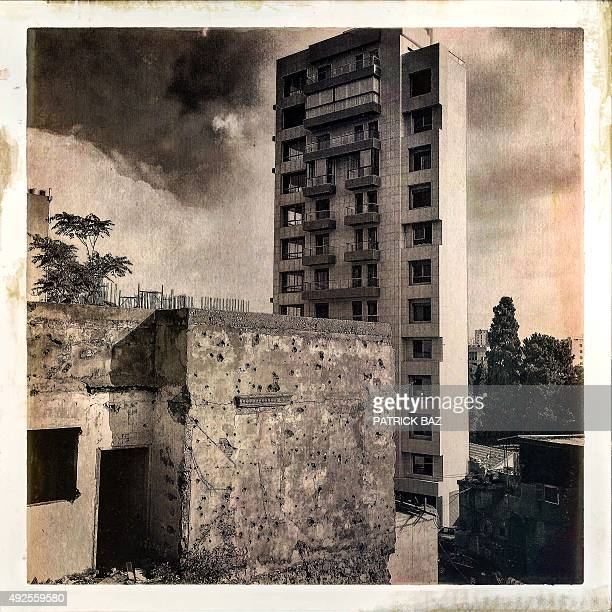 A picture taken with a Hipstamatic filter shows a modern building in Beirut standing next to a structure bearing the scars of the war in Lebanese...