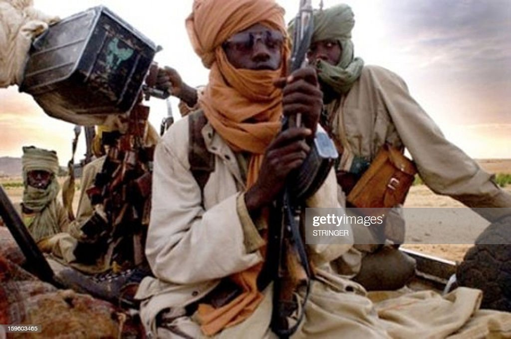 A picture taken with a mobile phone on January 12, 2013 reportedly shows Islamist insurgents in Gao. Fresh clashes erupted overnight between the Malian army, backed by French troops, and Islamic insurgents encircling the central town of Konna, military sources said today.