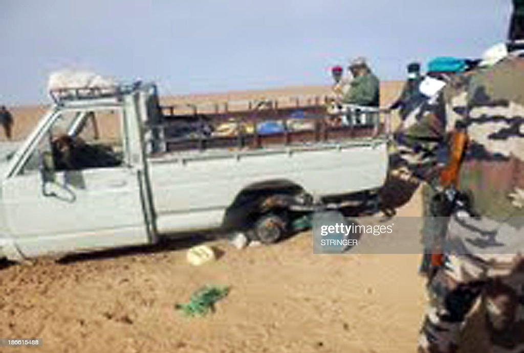 A picture taken with a mobile phone on October 30, 2013 and received on November 2, 2013 shows one of the trucks that was carrying some of 92 migrants who died of thirst in the harsh Niger desert, about a dozen kilometers from the Algerian border. Niger on November 1, 2013 ordered the 'immediate' closure of migrant camps in the north of the country after 92 people, mostly women and children, died of thirst trying to cross the harsh Sahara desert. The decomposed bodies of 52 children, 33 women and seven men were found on October 30 following their grisly death in October after two trucks carrying them broke down on the way to Algeria. Only 21 people survived out of 113 trying to cross Niger's desert border into Algeria in two trucks, which both broke down, according to a highly placed security source.
