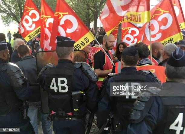 A picture taken with a mobile phone shows demonstrators protesting and facing police officers outside a nursery school prior to the arrival of French...