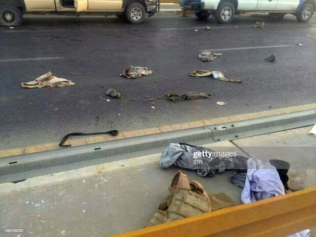 A picture taken with a mobile phone shows uniforms reportedly belonging to Iraqi security forces scattered on the road on June 10, 2014, after hundreds of militants from the Islamic State of Iraq and the Levant (ISIL) launched a major assault on the security forces in Mosul, some 370 kms north from the Iraqi capital Baghdad. Some 500,000 Iraqis have fled their homes in Iraq's second city Mosul after Jihadist militants took control, fearing increased violence, the International Organization for Migration said.