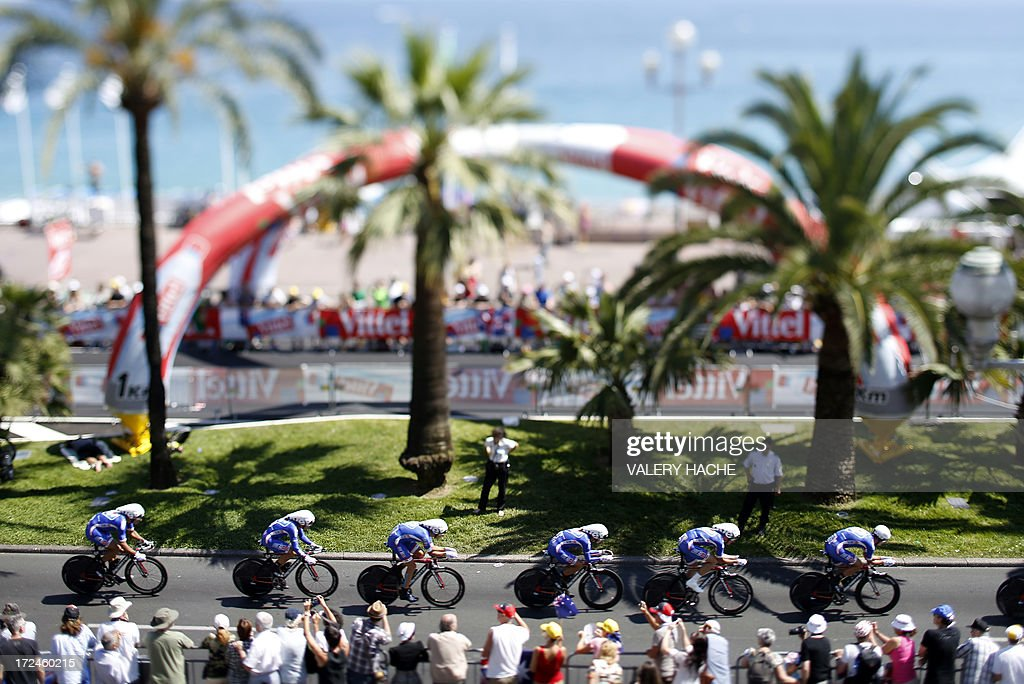 A picture taken with a tilt and shift lens on July 2, 2013 shows cyclists of the FDJ.fr team riding during the 25 km team time-trial and fourth stage of the 100th edition of the Tour de France cycling race in Nice, French Riviera. AFP PHOTO / VALERY HACHE