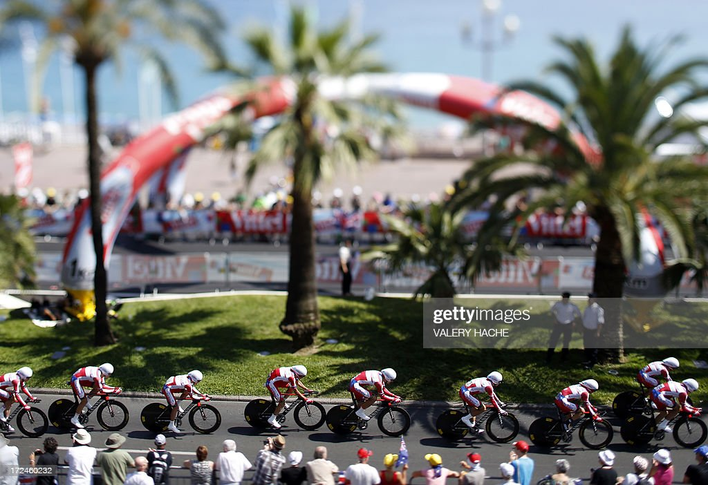 A picture taken with a tilt and shift lens on July 2, 2013 shows cyclists of the Katusha team riding during the 25 km team time-trial and fourth stage of the 100th edition of the Tour de France cycling race in Nice, French Riviera.