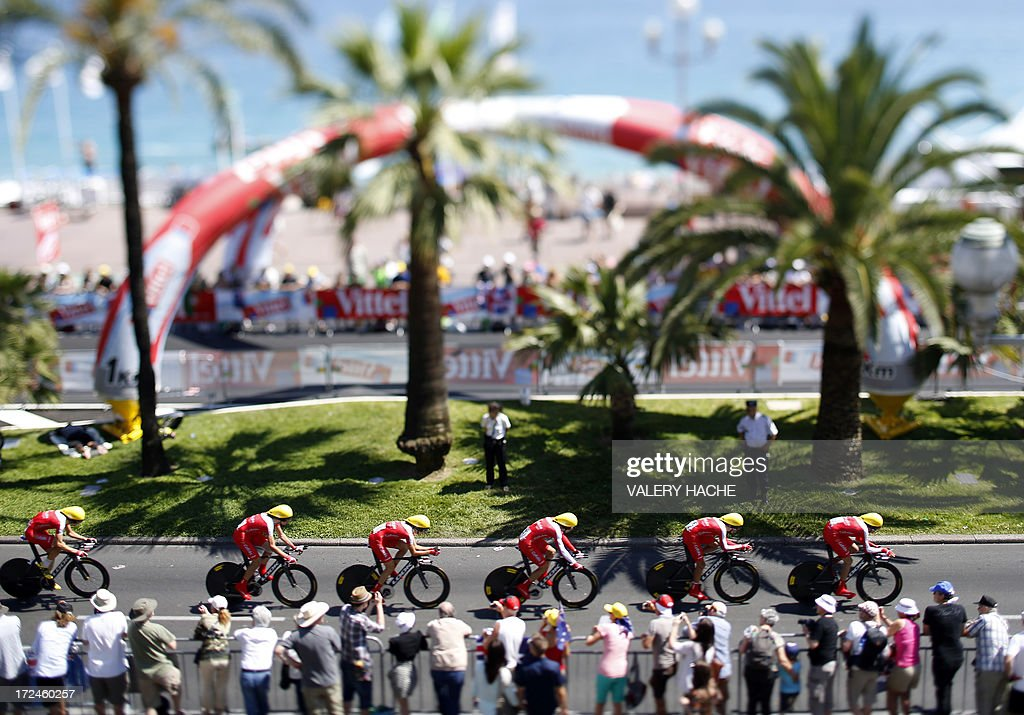 A picture taken with a tilt and shift lens on July 2, 2013 shows cyclists of the Cofidis team riding during the 25 km team time-trial and fourth stage of the 100th edition of the Tour de France cycling race in Nice, French Riviera.