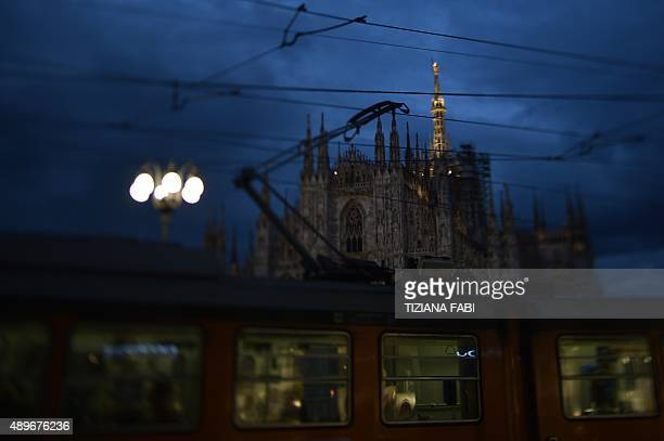 A picture taken with a tilt and shift lens shows a tram near Milan's cathedral at sunset during the women Spring / Summer 2016 Fashion Week on...