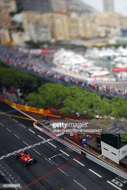 A picture taken with a tilt and shift lens shows Ferrari's Spanish driver Fernando Alonso driving at the Monaco street circuit during the second...