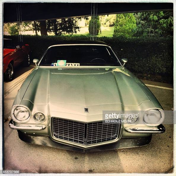 A picture taken with an Hipstamatic application shows a 1970 Chevrolet Camaro SS during a classic cars show at Saadabad palace in Tehran on August 5...