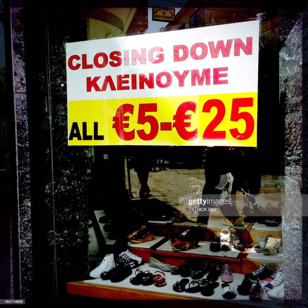 A picture taken with an iPhone using Hipstamatic shows a poster on a shoe shop in the centre of the old part of the Cypriot capital, Nicosia, in a shop window on March 27, 2013.