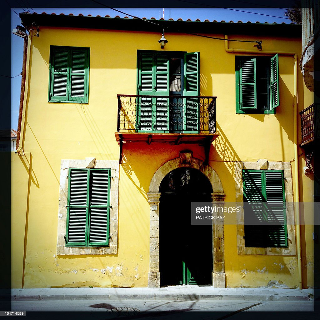 A picture taken with an iPhone using Hipstamatic shows a traditional house in the old part of the Cypriot capital, Nicosia, on March 27, 2013. AFP PHOTO/PATRICK BAZ