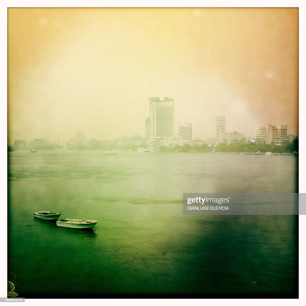 A picture taken with an iPhone using Hipstamatic shows the skyline of Cairo on May 13, 2013 as a sandstorm sweeps through the Egyptian capital.