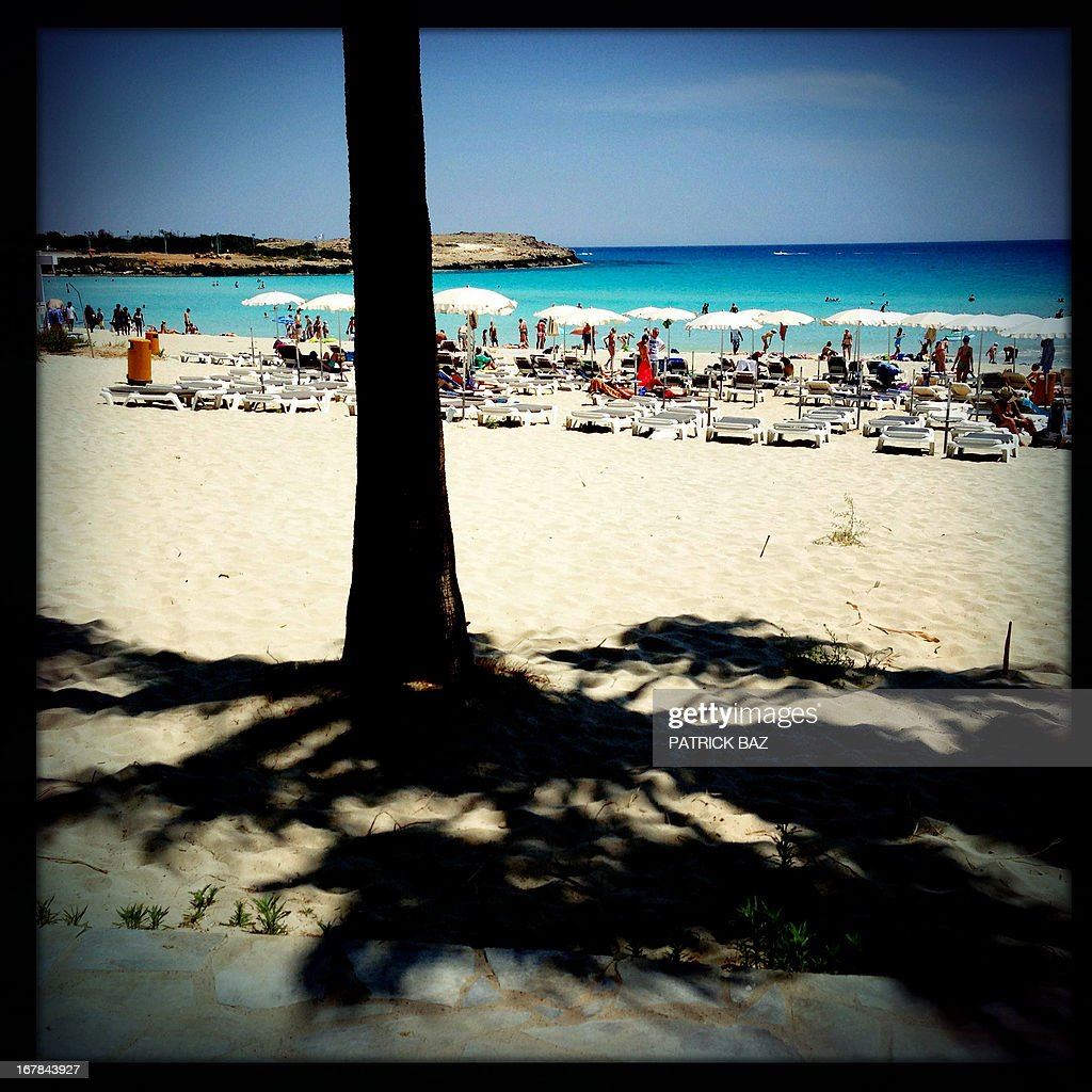 A picture taken with an iPhone using Hipstamatic shows tourists and Cypriots enjoying the Labour Day at Ayia Napa's Nissi beach on May 1, 2013 in Cyprus.