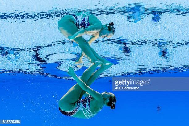 A picture taken with an underwater camera shows Canada's Jacqueline Simoneau competing in the Women Solo free routine final during the synchronised...