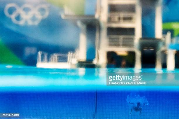 TOPSHOT A picture taken with an underwater camera shows China's Chen Aisen competing in the Men's 10m Platform final during the diving event at the...