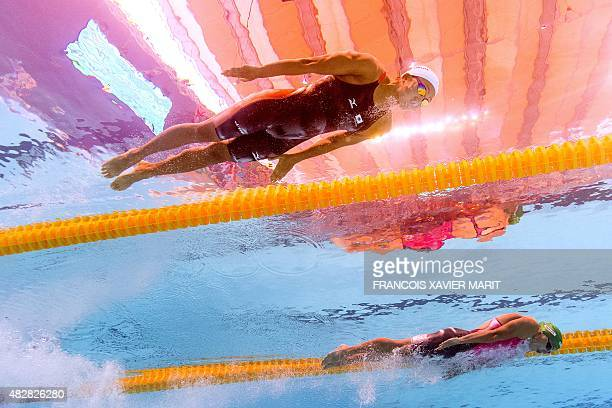 Picture taken with an underwater camera shows Japan's Watanabe Kanako competing in a preliminary heat of the women's 100m breaststroke swimming event...