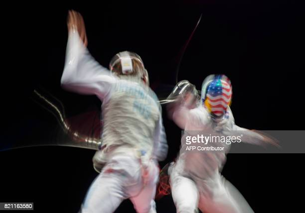 Picture taken with long time exposure shows Miles ChamleyWatson of the US and Russia's Alexey Cheremisinov during a qualification duel of the...