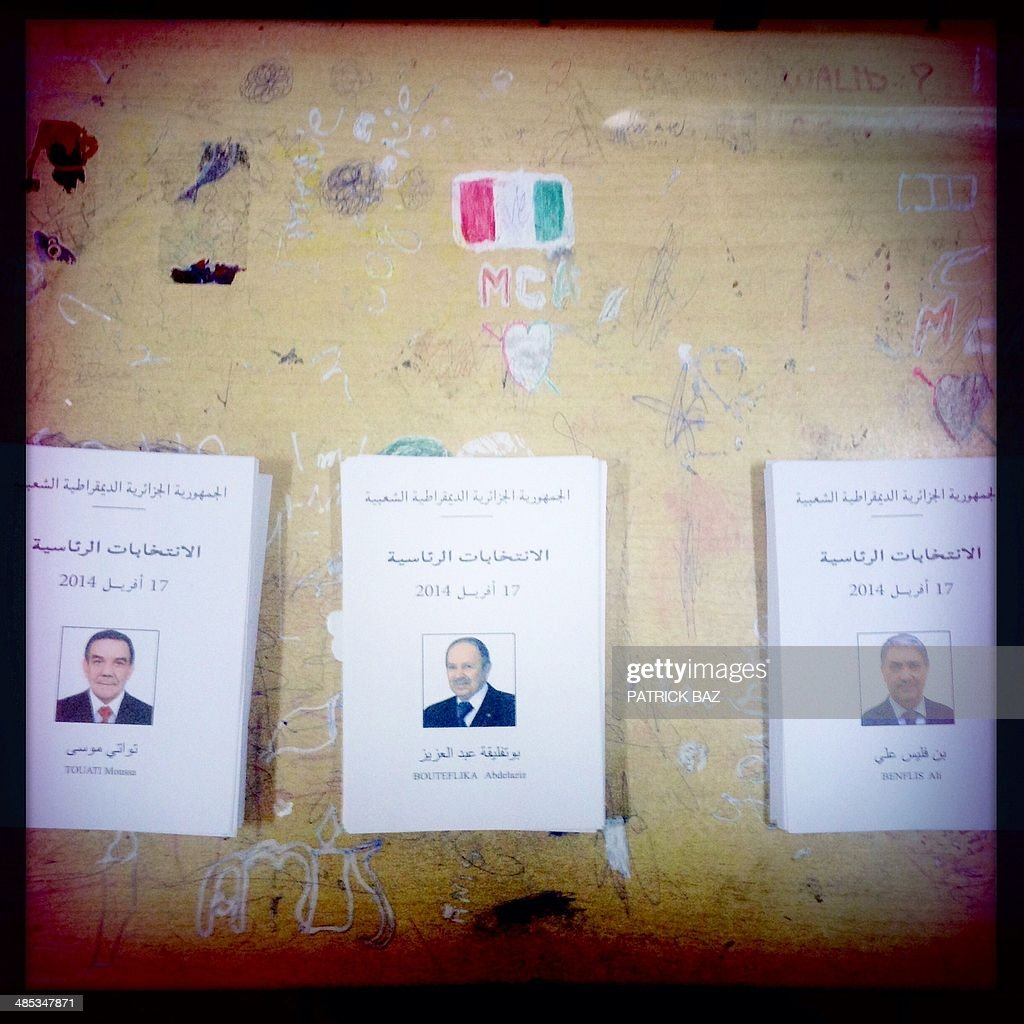 A picture taken with the Hipstamatic application shows ballots bearing portraits of candidates for the Algerian presidential elections and sitting on a classroom desk at a polling station in the capital Algiers on April 17, 2014. Algerians were voting in the presidential elections, with president-candidate Abdelaziz Bouteflika widely expected to win a fourth term despite chronic health problems, fraud warnings and calls for a boycott.