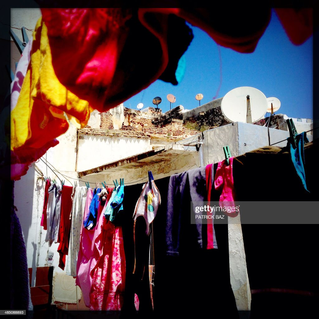 A picture taken with the Hipstamatic application shows laundry and satellite dishes in the old part of the capital Algiers, known as the Casbah, on April 16, 2014.