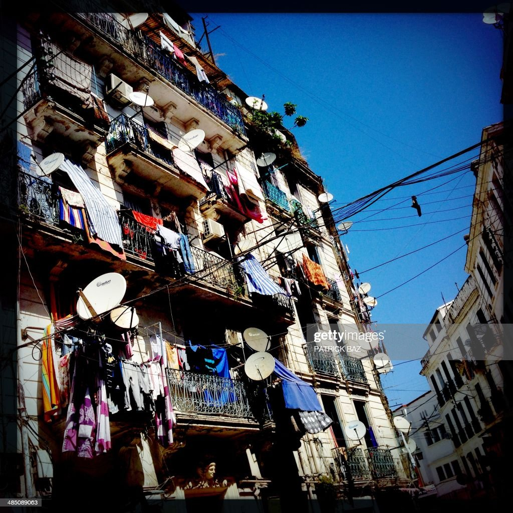 A picture taken with the Hipstamatic application shows laundry hanging on the balconies in the centre of the Algerian capital, Algiers, on April 16, 2014.