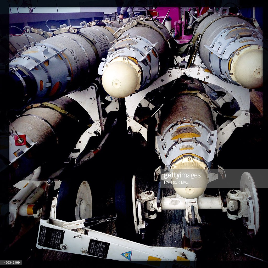 A picture taken with the Hipstamatic application shows MK82 bombs sitting on the deck of the US Navy aircraft carrier USS Harry S.Trumann (CVN 75) sailing in the Gulf of Oman on January 31, 2014.The French aircraft carrier Charles de Gaulle and the USS Harry S.Trumann (CVN 75) were conducting combined operations dubbed Bois Belleau.