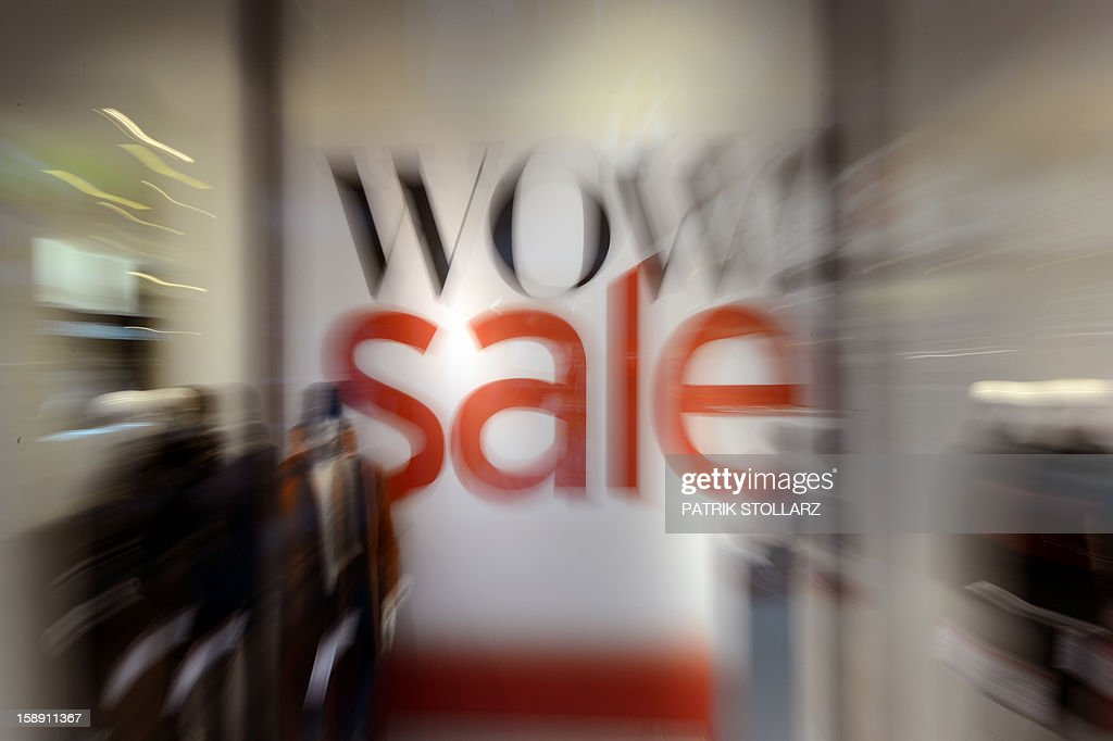 Picture taken with zoom- in effect shows an advertisement for a winter sale in a shop on January 3, 2013 in Essen, western Germany. Official start of the winter sale in Germany is on January 4, 2013. AFP PHOTO / PATRIK STOLLARZ