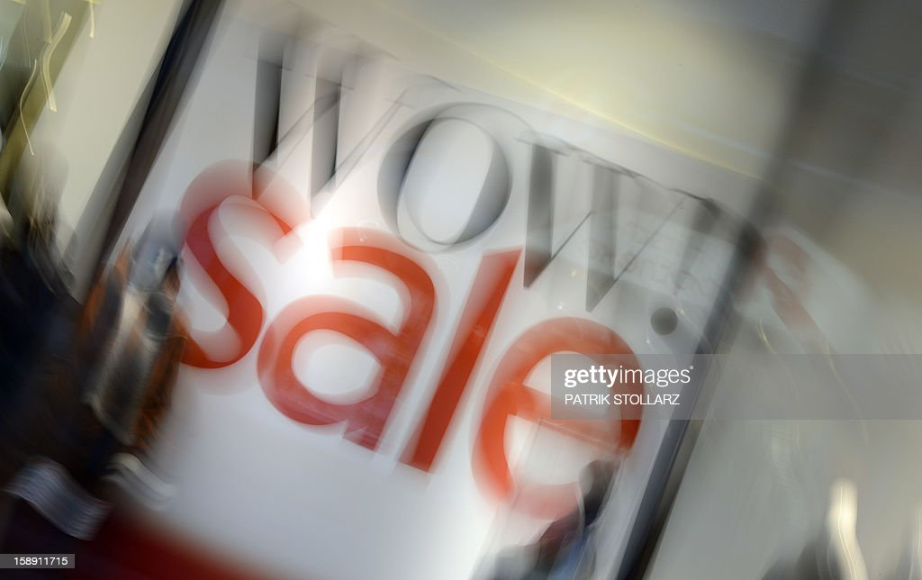 Picture taken with zoom- in effect shows an advertisement for a winter sale in a shop on January 3, 2013 in Essen, western Germany. Official start of the winter sale in Germany is on January 4, 2013.
