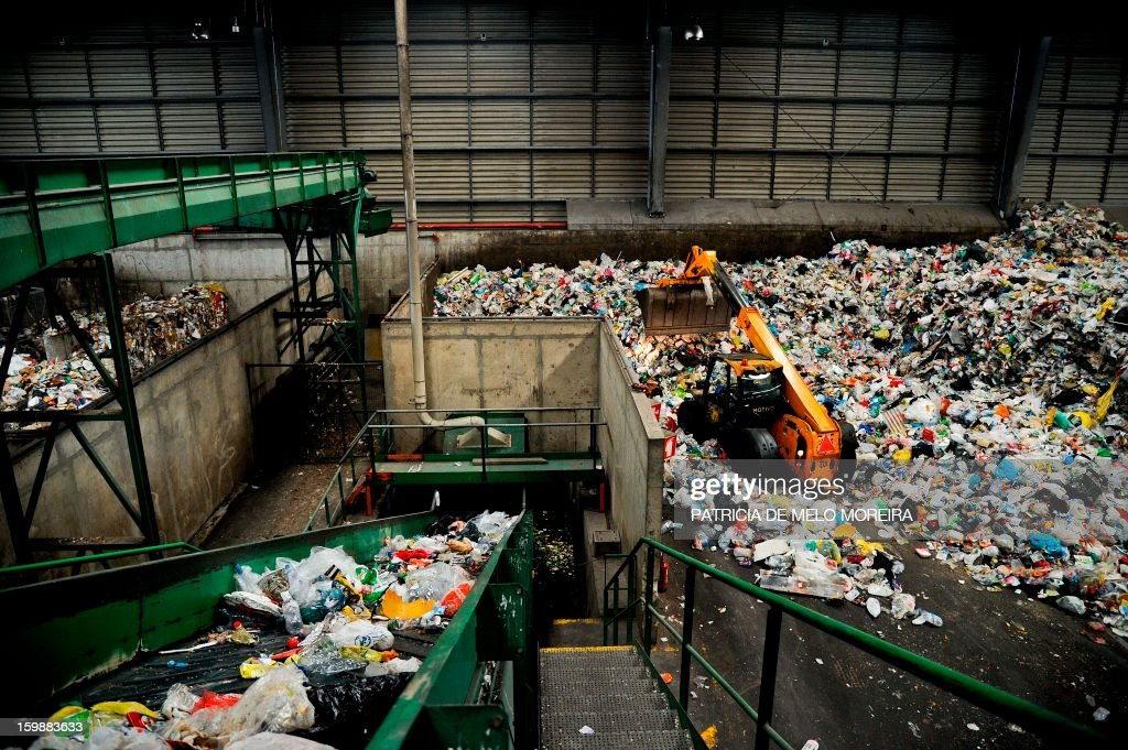 A picture takenon January 22, 2013 shows piles of garbage for recycling at Valorsul, a waste treatment plant, in Lisbon.