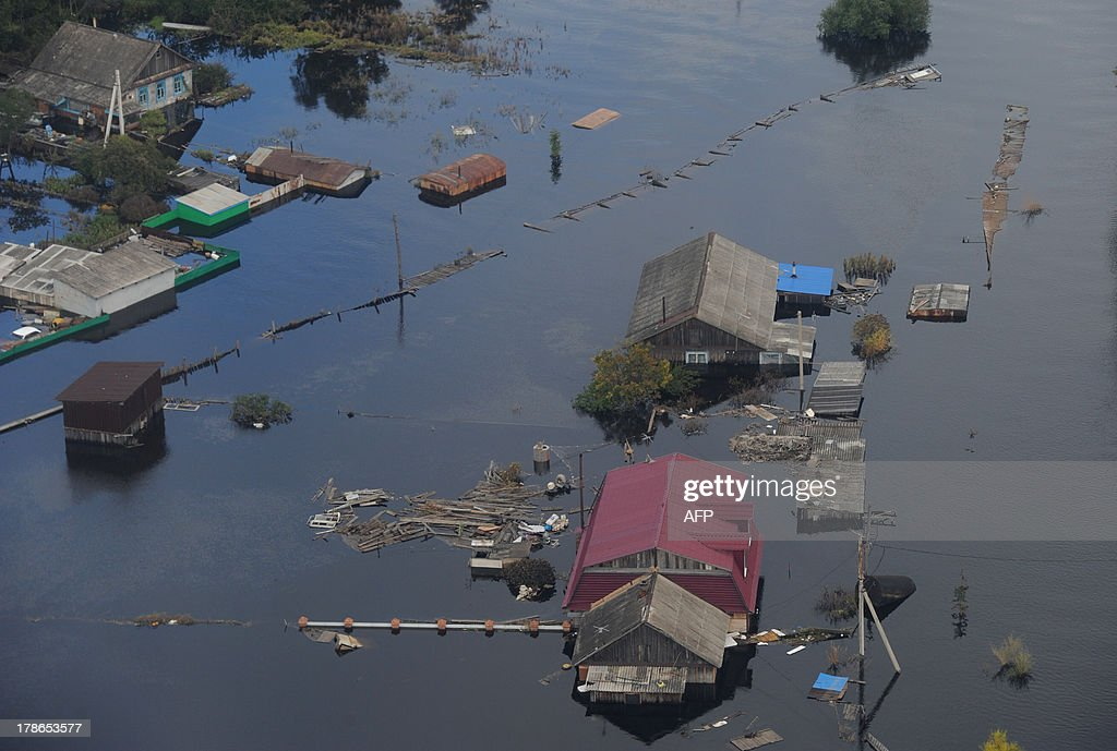A picture taking from a helicopter flying with Russia's President Vladimir Putin aboard shows a flooded area in the Russia's Far Eastern Jewish Autonomous Region , on August 30, 2013. Putin is on a two-day visit to the Russian Far East after floods of the Amur RIver that left at least thousands people homeless.