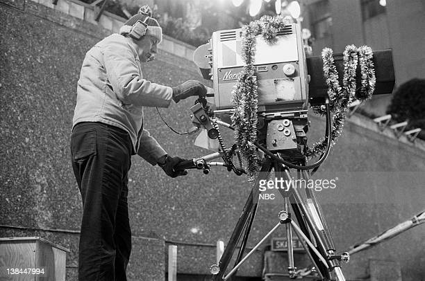 A cameraman records the Christmas tree lighting ceremony at Rockefeller Center